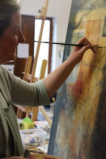 Artist Aideen Monaghan painting in Studio